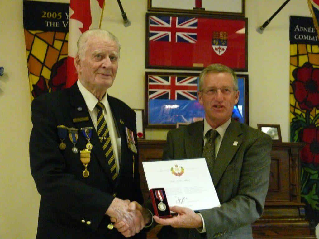 Les Allison receives the Queen's Jubilee Medal from MLA Blaine Pedersen-July 2012